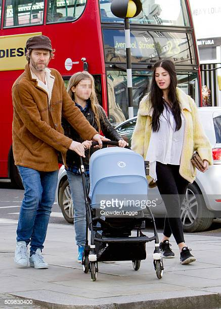 Howard Donald and wife Katie Halil are spotted out with their son Bowie on February 09 2016 in London England Part of this image has been pixellated...