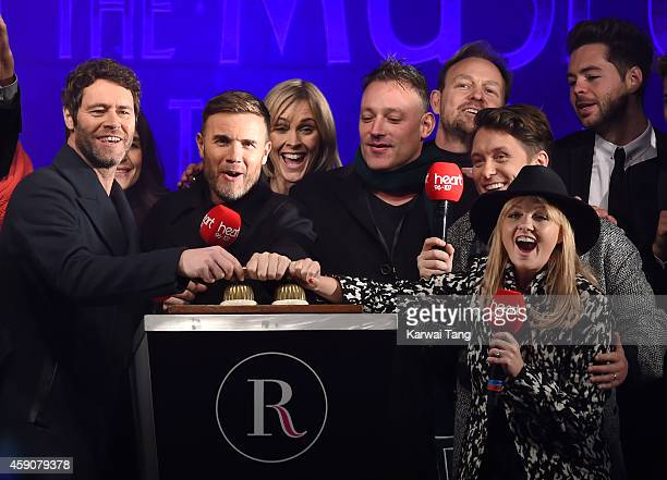 Howard Donald Gary Barlow and Mark Owen from Take That with Toby Antis Jason Donovan and Emma Bunton attend as the Regent Street Christmas Lights are...
