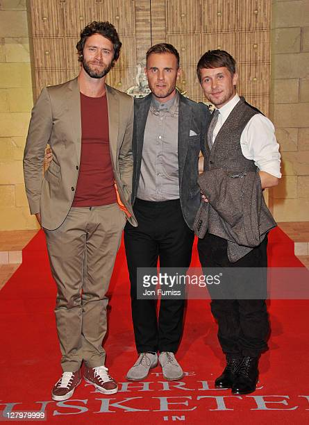 Howard Donald Gary Barlow and Mark Owen of Take That arrives at the Three Musketeers in 3D World Premiere at Vue Westfield on October 4 2011 in...