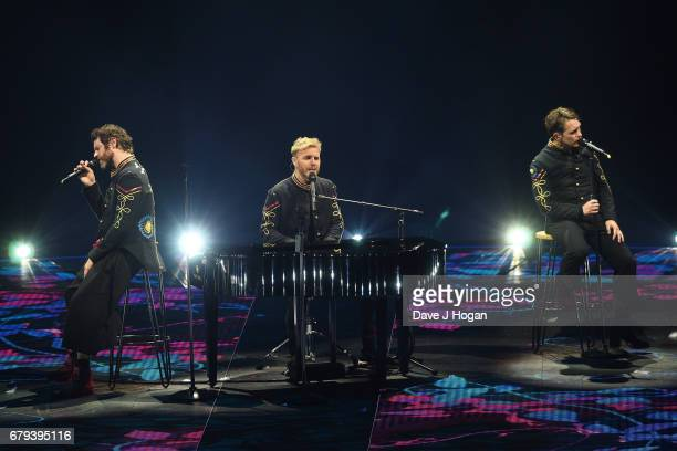 Howard Donald Gary Barlow and Mark Owen of Take That perform on the opening night of Wonderland Live 2017 at Genting Arena on May 5 2017 in...