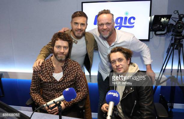 Howard Donald Gary Barlow and Mark Owen of Take That pose for a photo with Magic FM presenter Nick Snaith during a visit the Magic Radio studios on...
