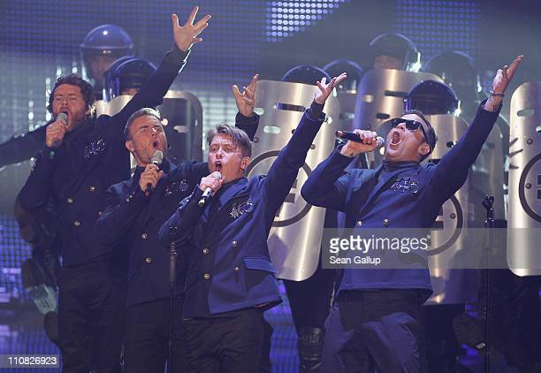 Howard Donald Gary Barlow Mark Owen and Robbie Williams of 'Take That' perform at the Echo Awards 2011 at Palais am Funkturm on March 24 2011 in...
