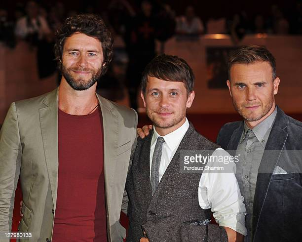 Howard Donald Mark Owen and Gary Barlow of Take That attend the world exclusive premiere of 'The Three Musketeers' in 3D at Vue Westfield on October...