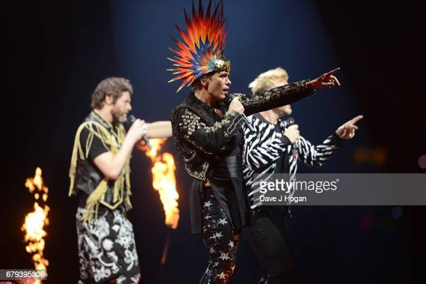 Howard Donald Mark Owen and Gary Barlow of Take That perform on the opening night of Wonderland Live 2017 at Genting Arena on May 5 2017 in...