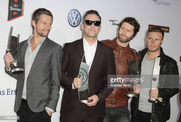 Howard Donald Robbie Williams Mark Owen and Gary Barlow of Take That pose with their award during the Echo award 2011 at Palais am Funkturm on March...