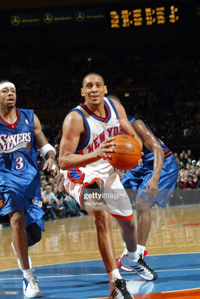 Howard Eisley #4 of the New York Knicks drives past Allen Iverson #3 of the Philadelphia 76ers on April 11, 2003 at Madison Square Garden in New York, New York.