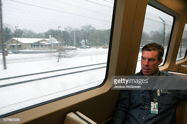 Howard Gable a mechanic for Delta Airlines rides Marta into work at Atlanta HartsfieldJackson International Airport during a snowstorm on January 10...