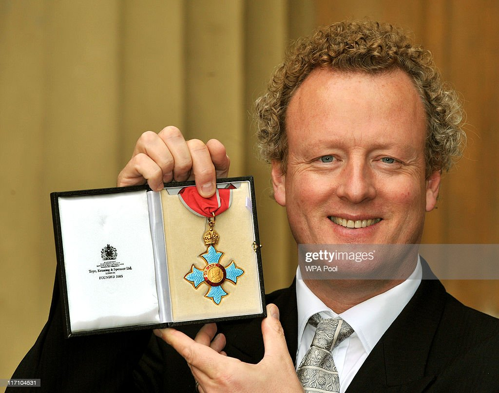 Howard Goodall, the National Ambassador for singing, holds his CBE after it was presented to him by the Prince of Wales, at the Investiture Ceremony on June 23, 2011 at Buckingham Palace, London.