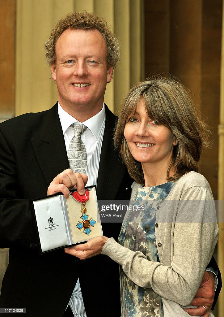 Howard Goodall, the National Ambassador for singing, holds his CBE with his wife Val, after it was presented to him by the Prince of Wales at the Investiture Ceremony on June 23, 2011 at Buckingham Palace, London.