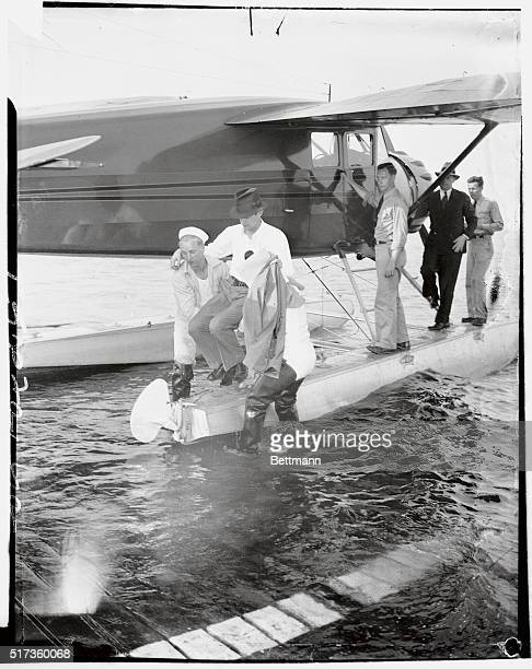 Howard Hughes millionaire sportsmanpilot is carried ashore after arriving at the US Coast Guard station in Jamaica Bay in a borrowed amphibian He...