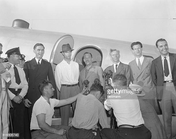 Howard Hughes multimillionaire speed flyer members of his crew and and Grover Whalen president of the New York World's Fair in front of the Hughes'...