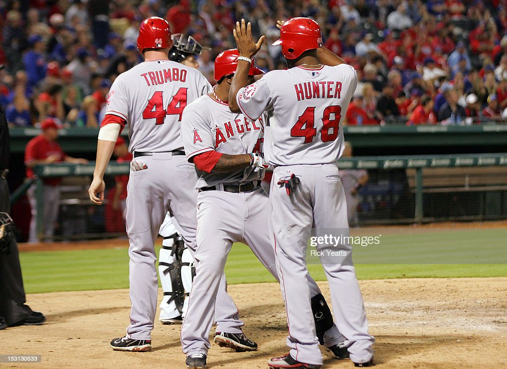 Howard Kendrick #47 celebrates with <a gi-track='captionPersonalityLinkClicked' href=/galleries/search?phrase=Torii+Hunter&family=editorial&specificpeople=183408 ng-click='$event.stopPropagation()'>Torii Hunter</a> #48 and \Mark Trumbo #44 of the Los Angeles Angels of Anaheim for Kendrick's three-run home run in game two of the double header at Rangers Ballpark in Arlington on September 30, 2012 in Arlington, Texas.