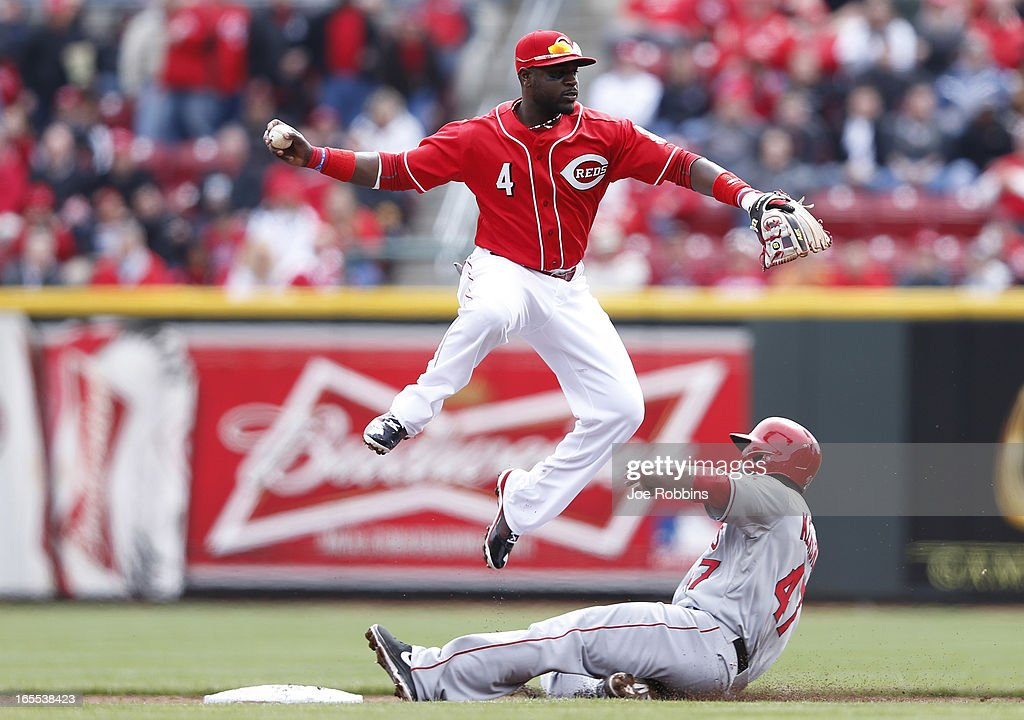 Howard Kendrick #47 of the Los Angeles Angels of Anaheim breaks up a double play attempt against Brandon Phillips #4 of the Cincinnati Reds during the game at Great American Ball Park on April 4, 2013 in Cincinnati, Ohio.