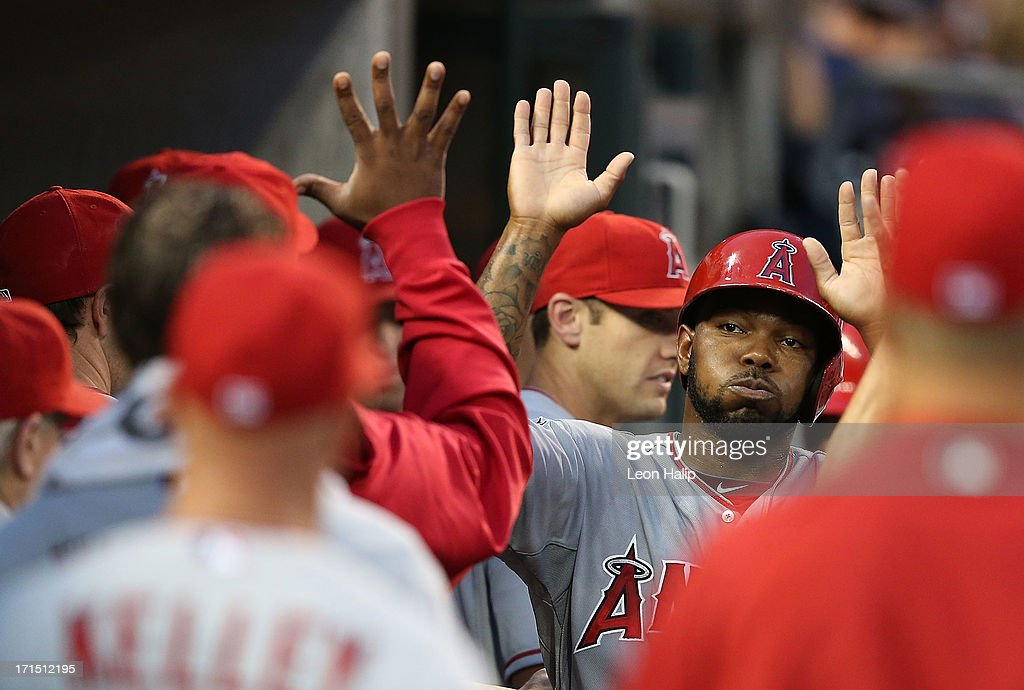 Howard Kendrick #47 of the Los Angeles Angels of Anaheim celebrates with his teammates after scoring on the walk to <a gi-track='captionPersonalityLinkClicked' href=/galleries/search?phrase=Hank+Conger&family=editorial&specificpeople=713039 ng-click='$event.stopPropagation()'>Hank Conger</a> #16 during the fifth inning of the game against the Detroit Tigers at Comerica Park on June 25, 2013 in Detroit, Michigan.
