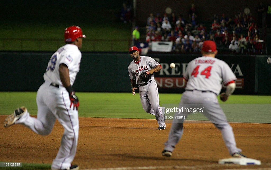 Howard Kendrick #47 tosses the ball to <a gi-track='captionPersonalityLinkClicked' href=/galleries/search?phrase=Mark+Trumbo&family=editorial&specificpeople=4921667 ng-click='$event.stopPropagation()'>Mark Trumbo</a> #44 of the Los Angeles Angels of Anaheim for the out on <a gi-track='captionPersonalityLinkClicked' href=/galleries/search?phrase=Adrian+Beltre&family=editorial&specificpeople=202631 ng-click='$event.stopPropagation()'>Adrian Beltre</a> #29 of the Texas Rangers in game two of the double header at Rangers Ballpark in Arlington on September 30, 2012 in Arlington, Texas.