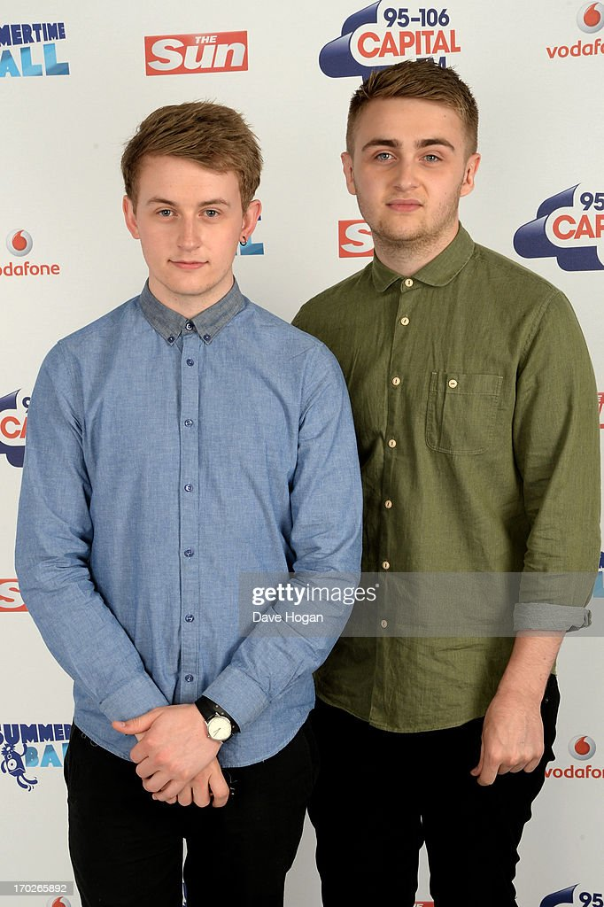 Howard Lawrence and Guy Lawrence of Disclosure pose in a backstage studio during the Capital Summertime Ball at Wembley Stadium on June 9, 2013 in London, England.