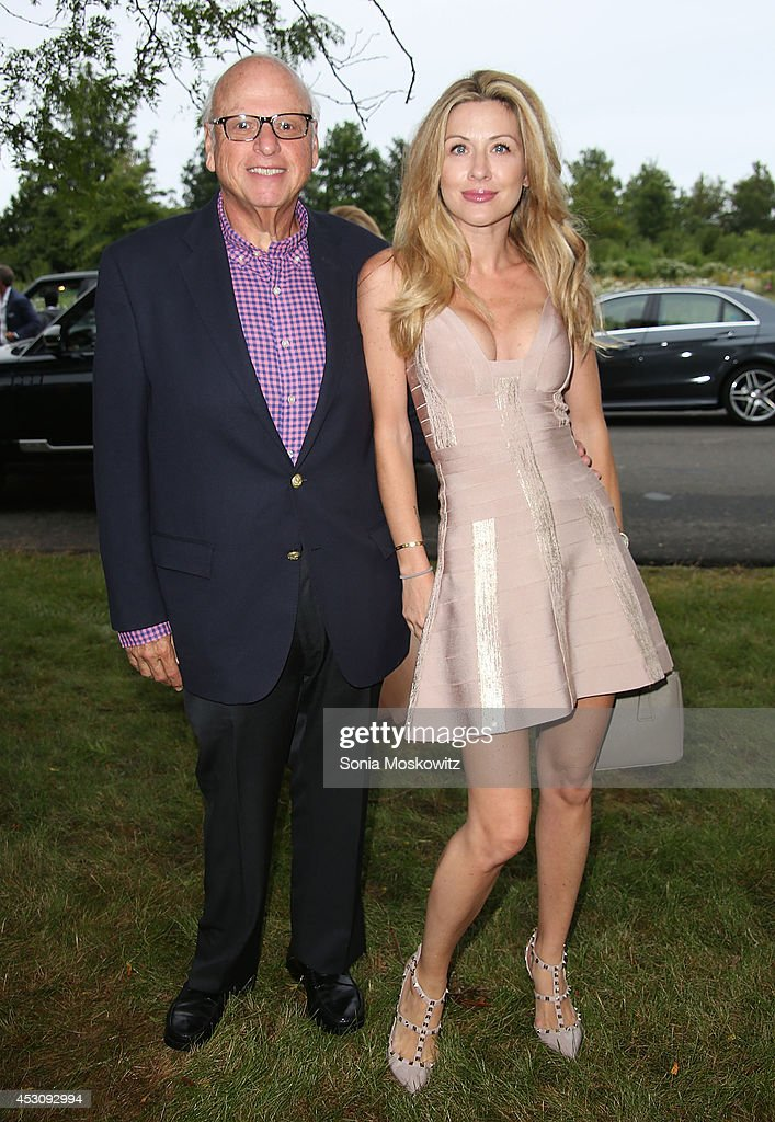 Howard Lorber and Jennine Gourin attend the Southampton Hospital's 56th Annual 'Endless Summmer' party on August 2, 2014 in Southampton, New York.
