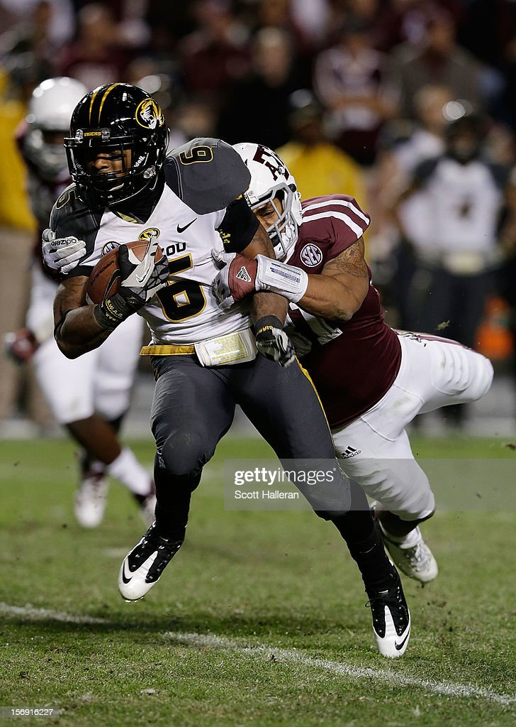 Howard Matthews #31 of Texas A&M Aggies tackles Marcus Murphy #6 of the Missouri Tigers at Kyle Field on November 24, 2012 in College Station, Texas.