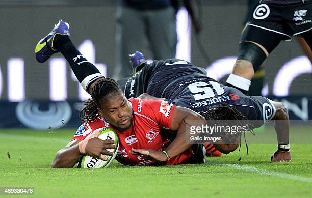 Howard Mnisi of the Lions dives over for his try during the Super Rugby Round 9 match between Emirates Lions and Cell C Sharks at Emirates Airline...