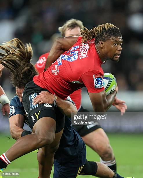Howard Mnisi of the Lions looks to offload during the round three Super Rugby match between the Highlanders and the Lions at Rugby Park on March 12...