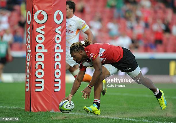 Howard Mnisi scores a try during the Super Rugby match between Emirates Lions and Toyota Cheetahs at Emirates Airline Park on March 19 2016 in...