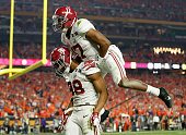J Howard of the Alabama Crimson Tide celebrates with his teammate Kenyan Drake after scoring a 51 yard touchdown in the fourth quarter against the...