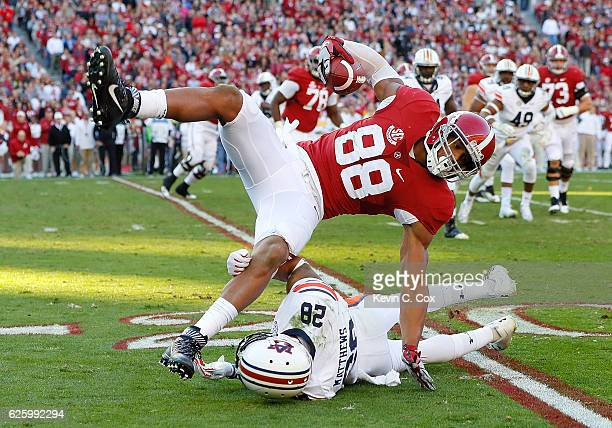 J Howard of the Alabama Crimson Tide is upended by Tray Matthews of the Auburn Tigers at BryantDenny Stadium on November 26 2016 in Tuscaloosa Alabama