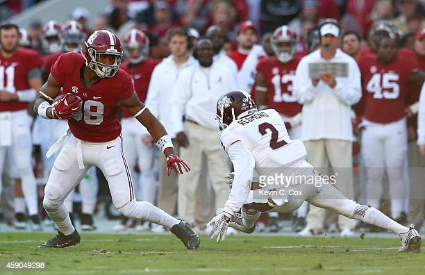 J Howard of the Alabama Crimson Tide pulls in this reception against Will Redmond of the Mississippi State Bulldogs at BryantDenny Stadium on...
