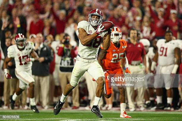 J Howard of the Alabama Crimson Tide scores a 51 yard touchdown in the fourth quarter against the Clemson Tigers during the 2016 College Football...