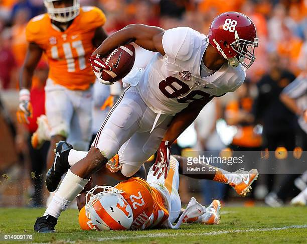 J Howard of the Alabama Crimson Tide tries to break a tackle by Micah Abernathy of the Tennessee Volunteers at Neyland Stadium on October 15 2016 in...