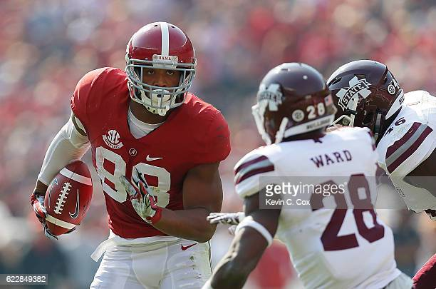 J Howard of the Alabama Crimson Tide turns up this reception against DeAndre Ward and Dezmond Harris of the Mississippi State Bulldogs at BryantDenny...
