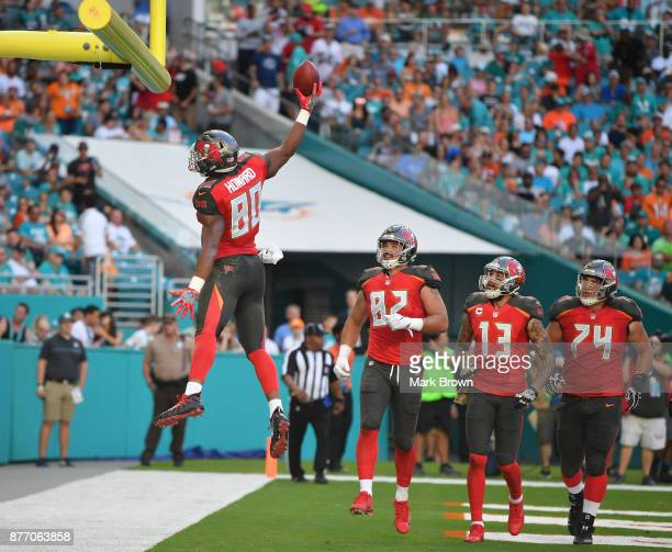 J Howard of the Tampa Bay Buccaneers celebrates a touchdown in the second quarter against the Miami Dolphins at Hard Rock Stadium on November 19 2017...