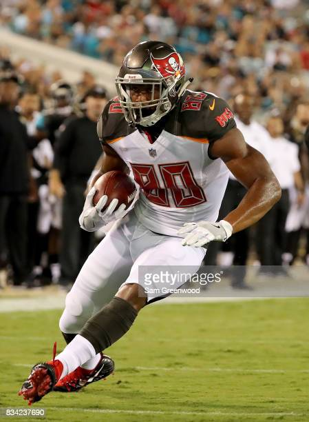 J Howard of the Tampa Bay Buccaneers runs for yardage during a preseason game against the Jacksonville Jaguars at EverBank Field on August 17 2017 in...