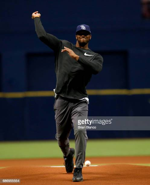 J Howard of the Tampa Bay Buccaneers throws out the ceremonial first pitch before the start of a game between the Tampa Bay Rays and the Los Angeles...