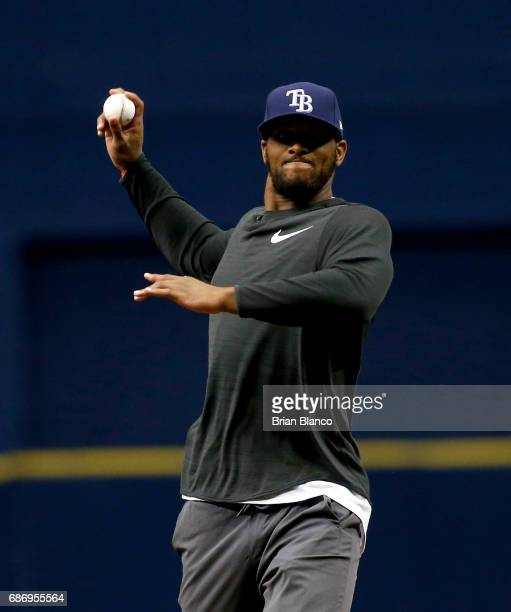 O J Howard of the Tampa Bay Buccaneers throws out the ceremonial first pitch before the start of a game between the Tampa Bay Rays and the Los...