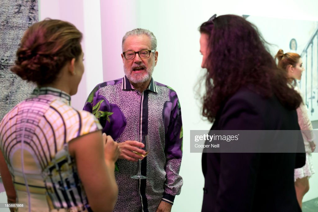 Howard Rachofsky speaks with guests during the Young Collectors Two x Two Cocktail party at the Rachofsky House on October 25, 2013 in Dallas, Texas.