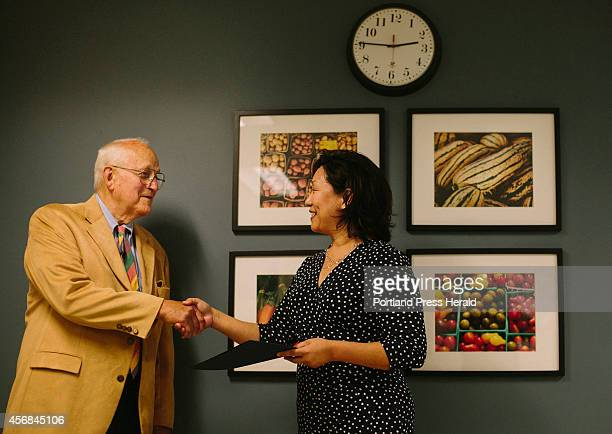 Howard Reiche Jr shakes Dean of Graduate Studies Carol Kim's hand as he is awarded a Master of Professional studies in biochemistry degree at the...