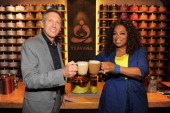 Howard Schultz chairman president and ceo of Starbucks and Oprah Winfrey visit the Teavana Fine Teas Tea Bar in New York to try the new Teavana Oprah...