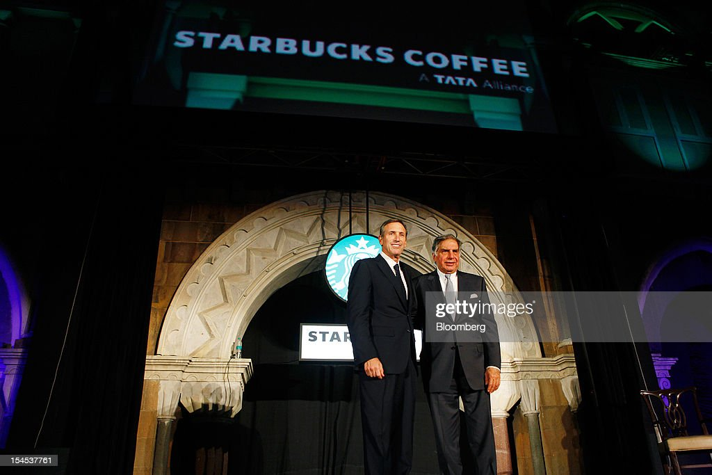Howard Schultz, chief executive officer of Starbucks Corp., left, and Ratan Tata, chairman of Tata Group, pose for a photograph during the opening of the first Starbucks India outlet in Mumbai, India, on Friday, Oct. 19, 2012. Starbucks, which opened its first store in India today, will maintain its partnership with Tata Global Beverages Ltd. and plans to take some of that company's products to new markets, Schultz said. Photographer: Dhiraj Singh/Bloomberg via Getty Images
