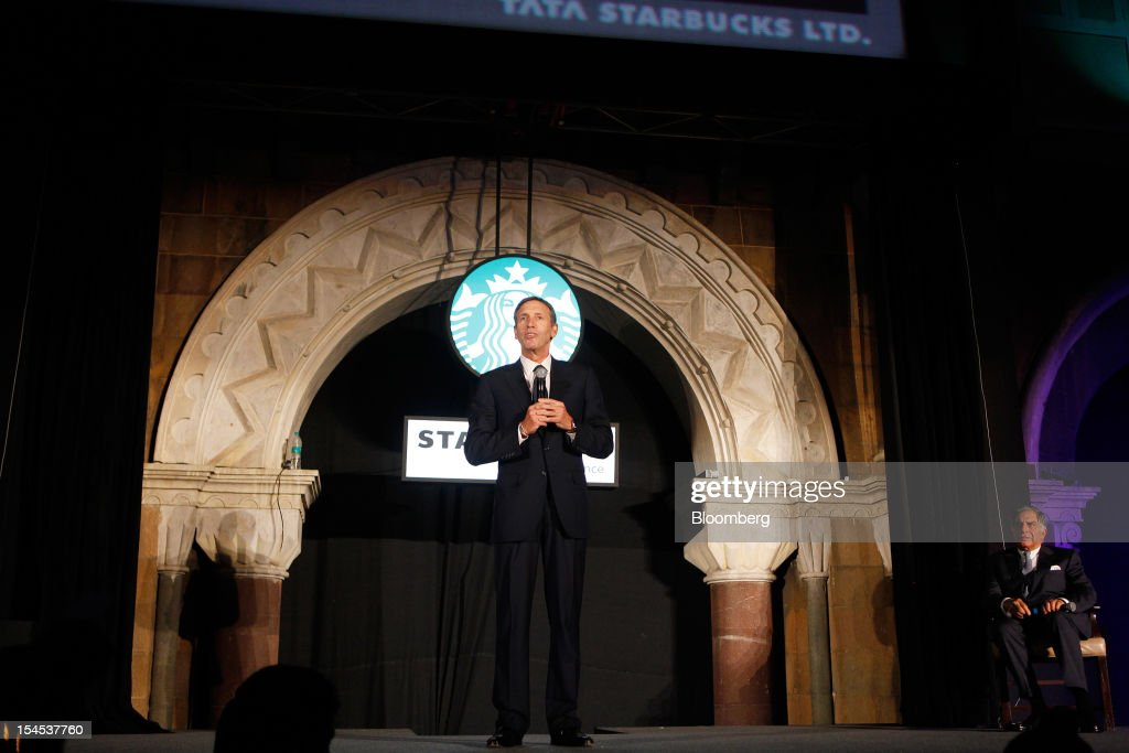 <a gi-track='captionPersonalityLinkClicked' href=/galleries/search?phrase=Howard+Schultz&family=editorial&specificpeople=595766 ng-click='$event.stopPropagation()'>Howard Schultz</a>, chief executive officer of Starbucks Corp., left, speaks while <a gi-track='captionPersonalityLinkClicked' href=/galleries/search?phrase=Ratan+Tata&family=editorial&specificpeople=649518 ng-click='$event.stopPropagation()'>Ratan Tata</a>, chairman of Tata Group, listens during the opening of the first Starbucks India outlet in Mumbai, India, on Friday, Oct. 19, 2012. Starbucks, which opened its first store in India today, will maintain its partnership with Tata Global Beverages Ltd. and plans to take some of that company's products to new markets, Schultz said. Photographer: Dhiraj Singh/Bloomberg via Getty Images