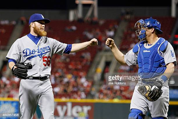 P Howell and Tim Federowicz of the Los Angeles Dodgers celebrate after a double play that ended the seventh inning of the game against the Cincinnati...