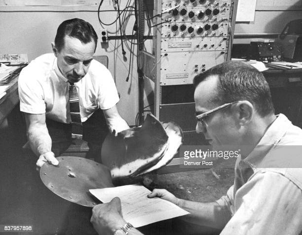 Howell Left And Burkitt Examine The Target After Firing Minute glass beads are used to simulate particles which Zip around in space Credit Denver Post