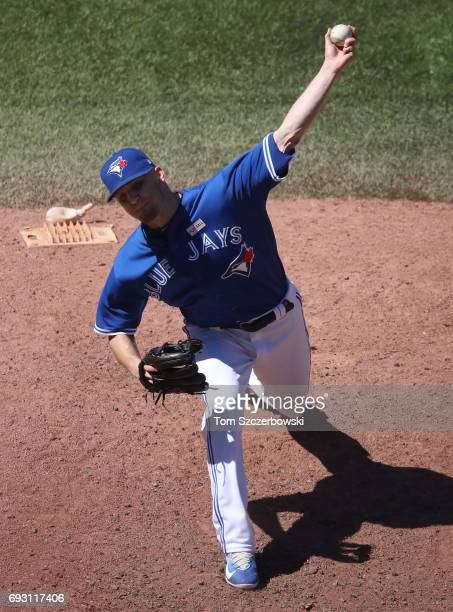 P Howell of the Toronto Blue Jays delivers a pitch in the eighth inning during MLB game action against the New York Yankees at Rogers Centre on June...