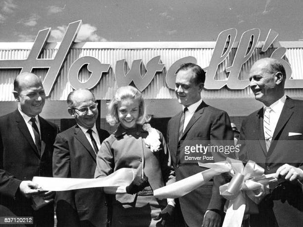 Howell's Arvada Branch Opens Arvada's Cheryl Sweeten Miss Colorado 1963 cuts the ribbon at the formal opening Thursday of the Arvada branch of...