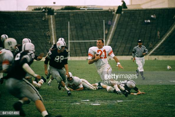 An unidentified player of the Maryland Terrapins runs with the ball without his helmet after intercepting a pass during the game against the ranked...