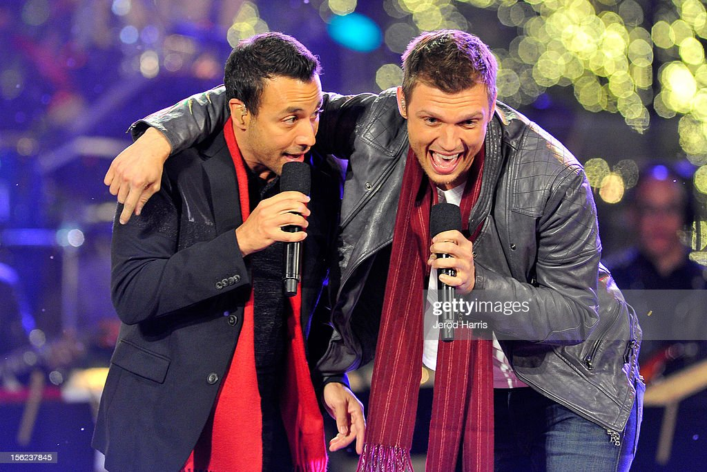 Howie Dorough (L) and Nick Cater of The Backstreet Boys performs at A Hollywood Christmas Celebration at The Grove on November 11, 2012 in Los Angeles, California.