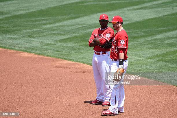 Howie Kendrick and CJ Cron of the Los Angeles Angels of Anaheim wait in the infield during the game against the Kansas City Royals at Angel Stadium...