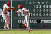 Howie Kendrick and Erick Aybar of the Los Angeles Angels of Anaheim celebrate a 95 win over the Boston Red Sox during the first game of a...