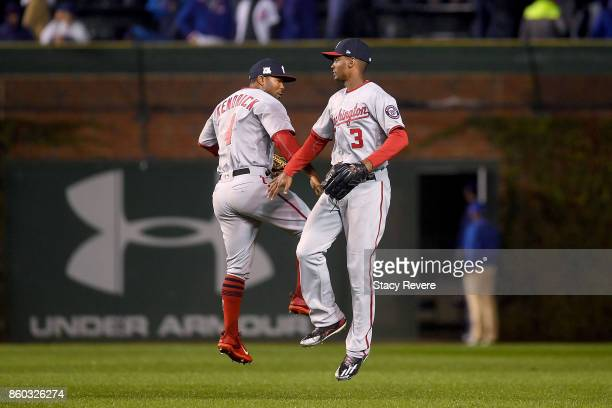 Howie Kendrick and Michael A Taylor of the Washington Nationals celebrate after defeating the Chicago Cubs 50 in game four of the National League...