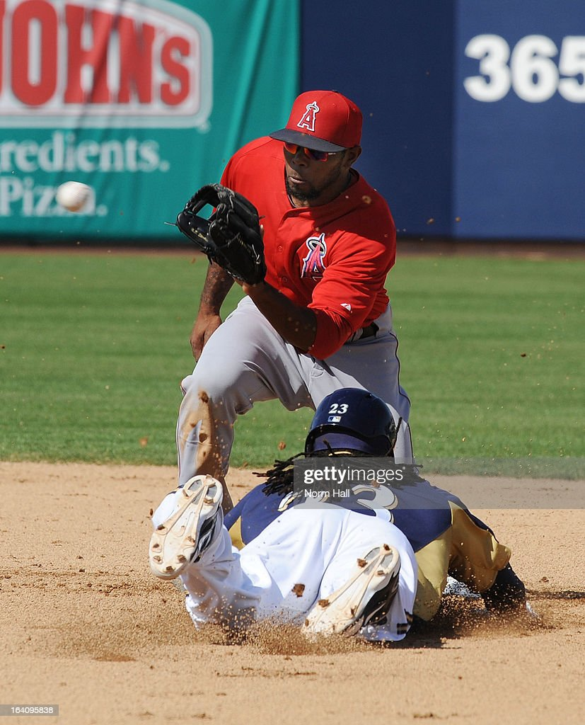 Howie Kendrick #47 of the Los Angeles Angels of Anaheim catches a throw from home plate as Rickie Weeks #23 of the Milwaukee Brewers attempts to steal second base at Maryvale Baseball Park on March 19, 2013 in Maryvale, Arizona.